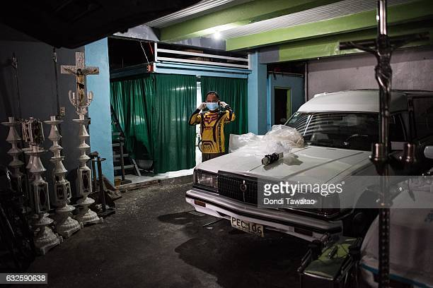 Funeral workers prepare before carrying unclaimed bodies set to be buried in a public cemetery on January 24 2017 in Manila Philippines Many bodies...