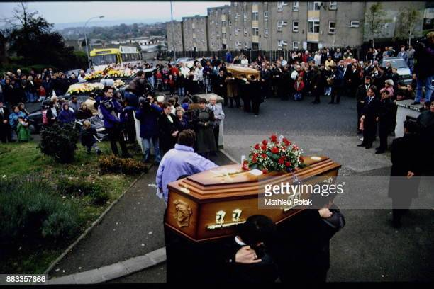 Funerals for catholic victims in Belfast funeral cortege of Mark Rodgers and Jimmy Cameron killed in agunfire