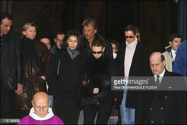 Funerals of Ticky Holgado in Paris, France on January 26, 2004 - Mrs. Holgado and her daughter, Johnny Hallyday and Laeticia.
