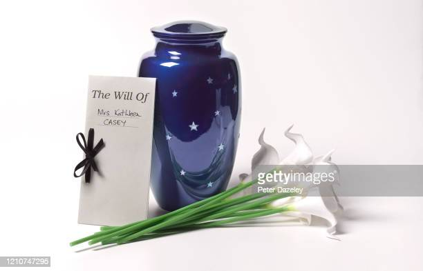funerary urn with last will and testament and lillies - 火葬 ストックフォトと画像