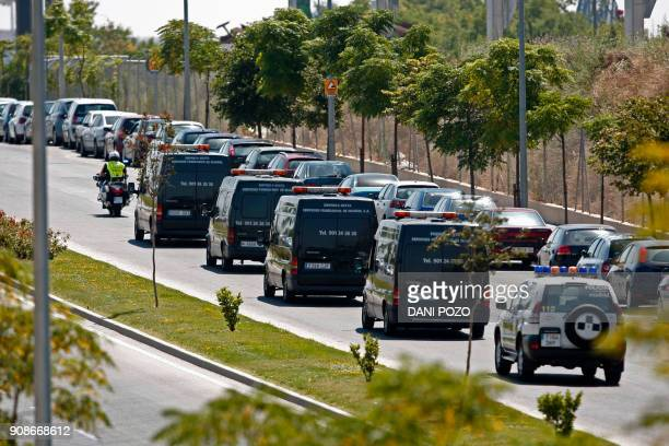 Funerary vehicles leave Madrid's IFEMA fairgrounds where bodies from the Barajas airport crash were identified on August 21 2008 A total of 153...
