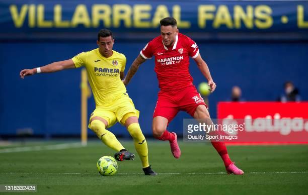 Funes Mori of Villarreal CF competes for the ball with Lucas Ocampos of Sevilla FC during the La Liga Santander match between Villarreal CF and...