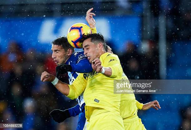 Funes Mori of Villarreal CF duels for the ball with Jonathan Calleri of Deportivo Alaves during the La Liga match between Deportivo Alaves and...