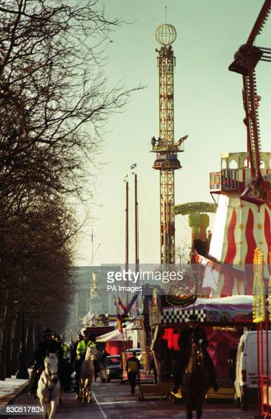 A funfair being built on the Mall in London in preparation for New Year's celebrations The gravity based Drop Tower is shown centre and there is also...
