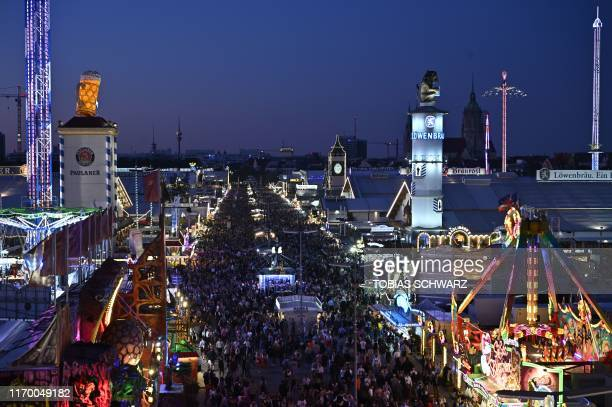 Funfair rides are illuminated at the Theresienwiese fair grounds during the opening day of the Oktoberfest beer festival in Munich, southern Germany,...