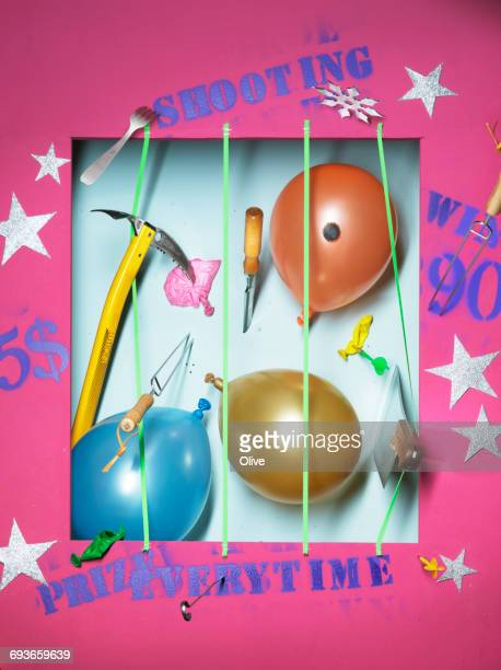 funfair stand with bursted ballons