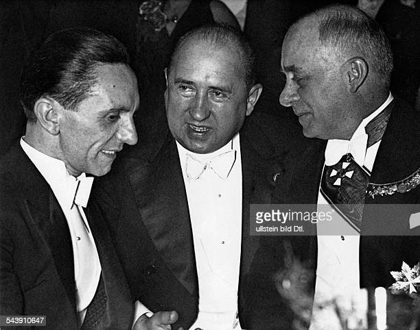 Funk Walther Politiker NSDAP D*18081890 at the Presseball in Berlin between Joseph Goebbels and Doeme Sztojay at this time hungarian millitary...