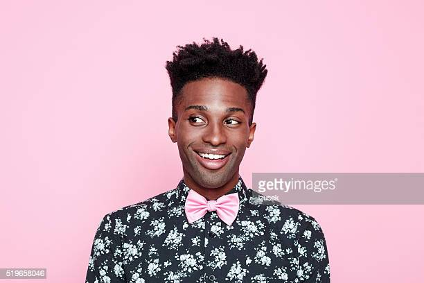 funky afro american guy against pink background - bow tie stock pictures, royalty-free photos & images