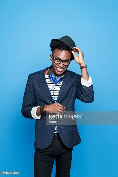 Funky afro american guy in fashionable outfit