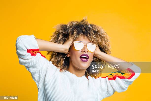 funky afro girl against yellow background - sunglasses stock pictures, royalty-free photos & images