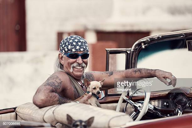 Funky man and dogs in Cuba