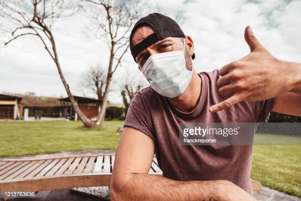 funky man in quarantine with covid - funny surgical mask stock pictures, royalty-free photos & images