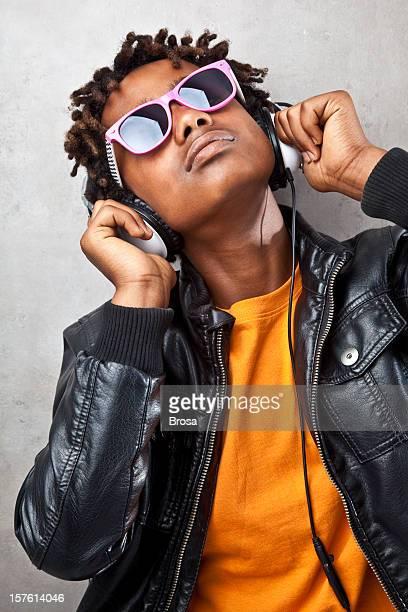 Funky teenager listening to headphones