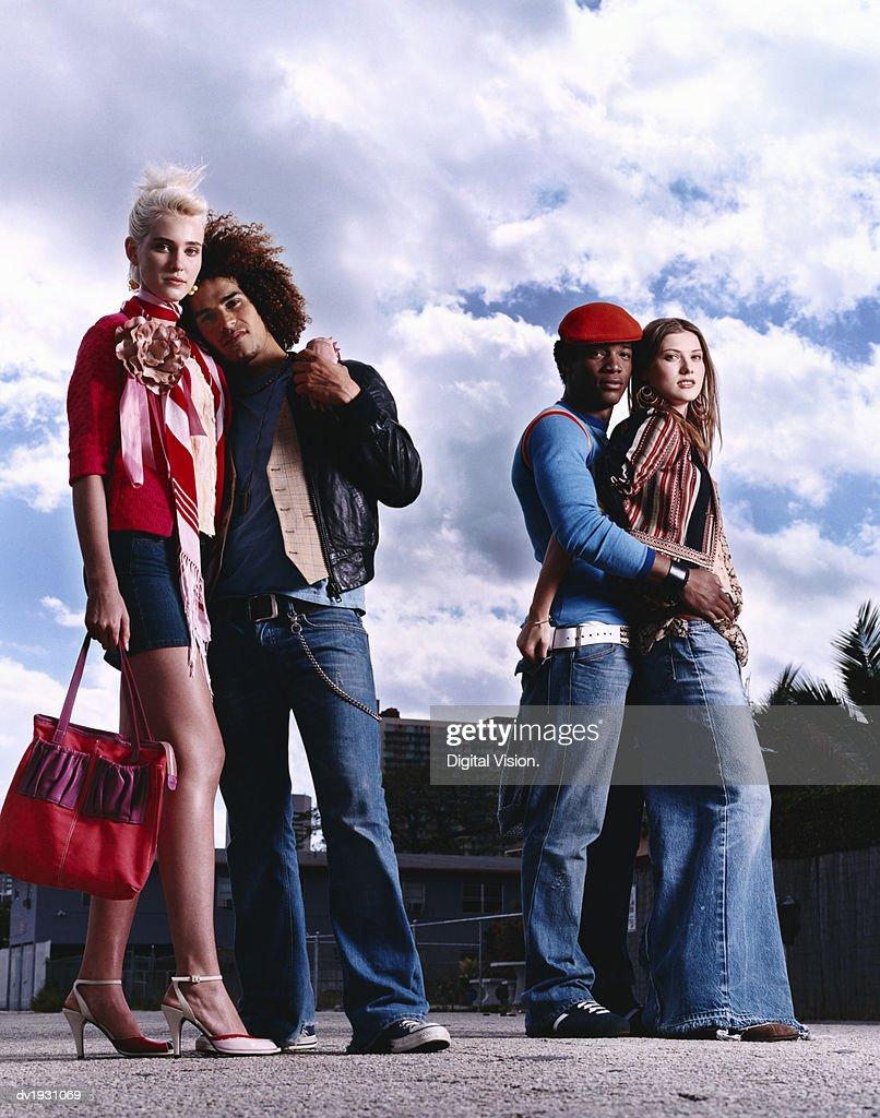 Funky Twentysomething Couples Standing on an Urban Street : Stock Photo
