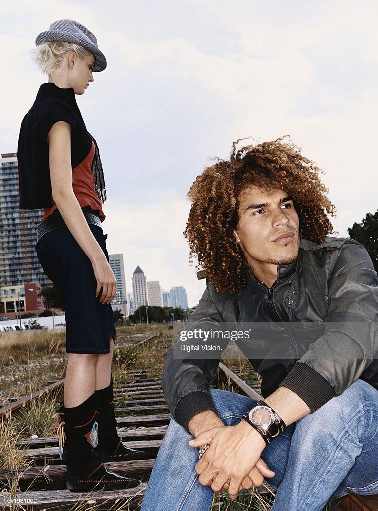 Funky Twentysomething Man and Woman on an Urban Railway Track : Stock Photo