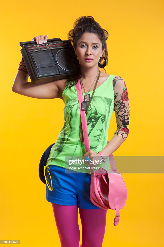 Funky woman listening to cassette player : Stock Photo
