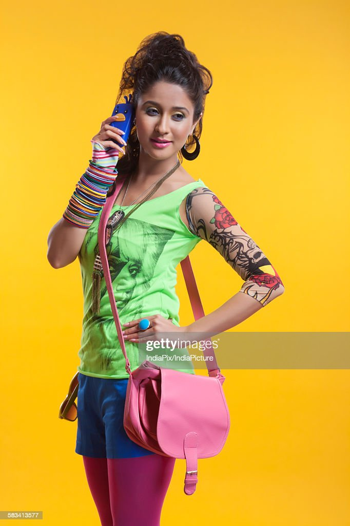 Funky woman talking on mobile phone : Stock Photo