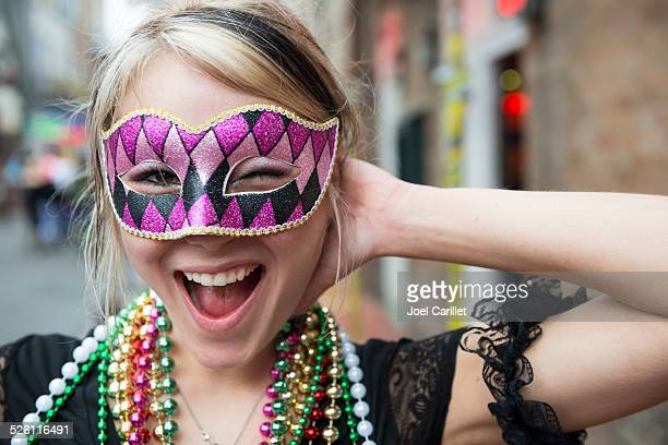 fun-loving young woman at mardi gras in new orleans louisiana - new orleans french quarter stock photos and pictures