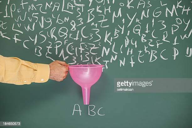 Funnel In Human Hand Searching Filtering Words Written On Blackboard