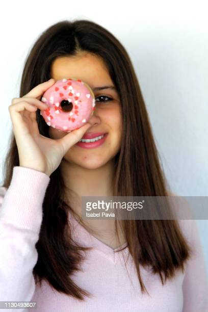 Funny beauty woman looking through pink donut. Diet, dieting concept. Junk food, Slimming, weight loss