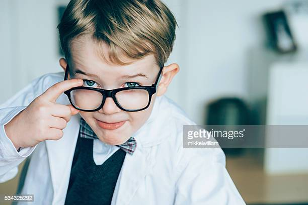 funny boy with bow tie and glasses makes a face - child prodigy stock pictures, royalty-free photos & images