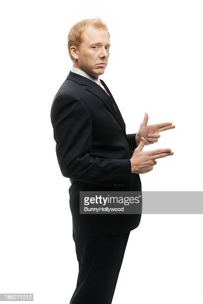 Funny Businessman gun slinger on White