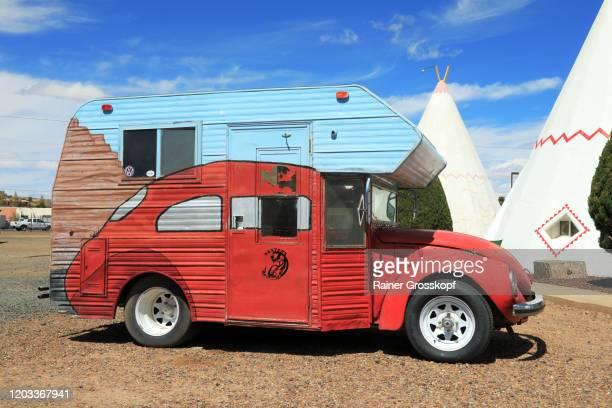 funny car between wigwam tents - rainer grosskopf stockfoto's en -beelden
