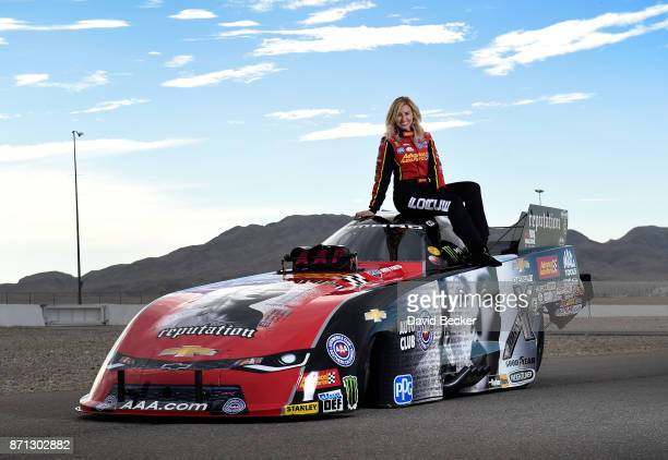 Funny Car driver Courtney Force poses with her Advance Auto Parts Chevrolet Camaro SS funny car featuring the cover of Big Machine Records recording...