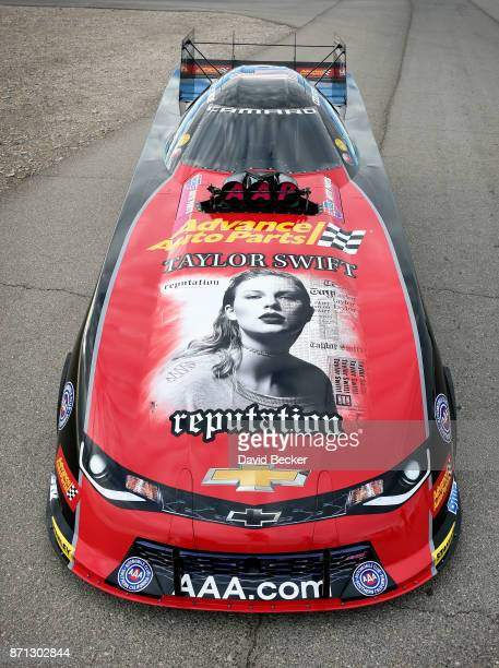 Funny Car driver Courtney Force's Advance Auto Parts Chevrolet Camaro SS funny car is seen featuring the cover of Big Machine Records recording...