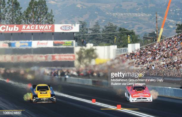 Funny Car driver JR Todd defeats Bob Tasca during the quarterfinal round of eliminations in Pomona on Sunday November 11 2018 at the 54th annual NHRA...