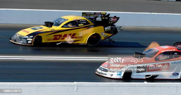 Funny Car driver JR Todd pulls away from Bob Tasca for the round win during the quarterfinal round of eliminations in Pomona on Sunday November 11...