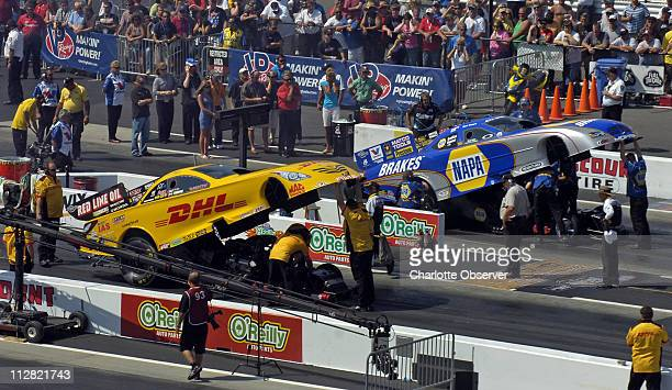 Funny Car drivers Jeff Arend and Ron Capps prepare to make a qualifying run at the O'Reilly Nationals in Concord North Carolina Saturday September 18...