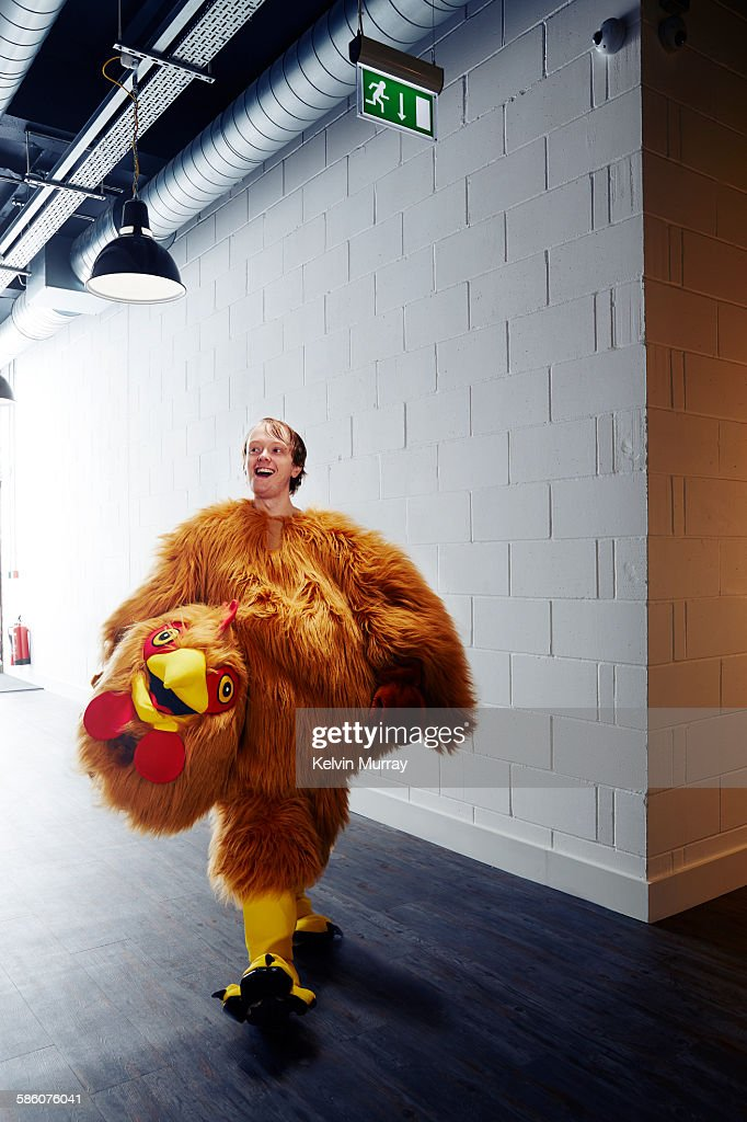 Funny chicken costume mascot smiling after event : Stock Photo