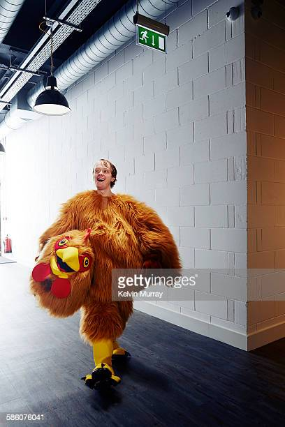 funny chicken costume mascot smiling after event - animal costume stock pictures, royalty-free photos & images
