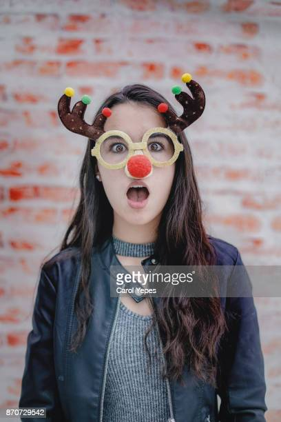 funny christmas brunette woman portrait - funny christmas stock photos and pictures