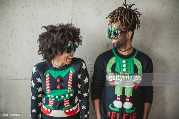 funny christmas couple - sweater stock pictures, royalty-free photos & images