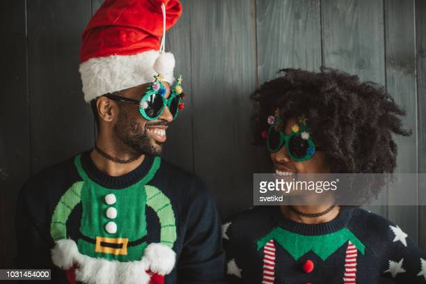 funny christmas couple - ugly black women stock photos and pictures