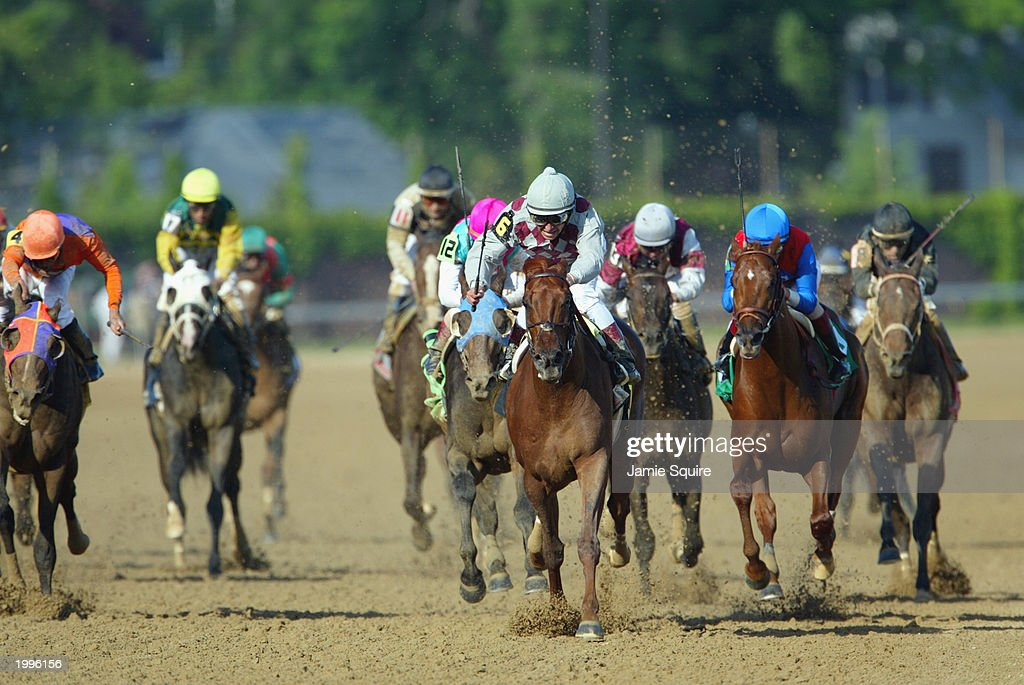 Funny Cide With Jockey Jose Santos Up Races To The Finish Line To