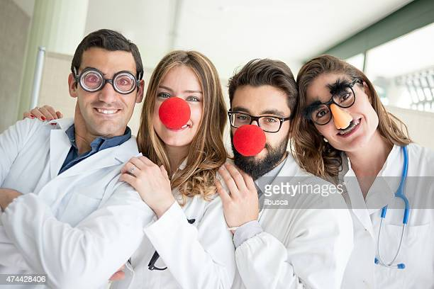 funny clown doctors pediatricians - clown's nose stock photos and pictures
