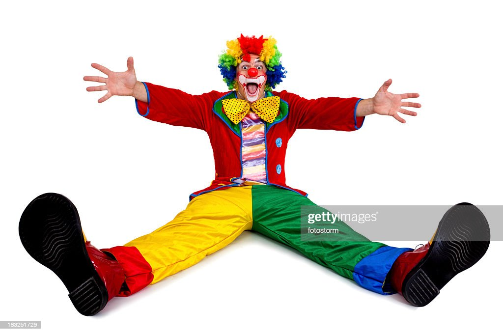 Funny clown sitting with arms and legs outstretched : Stock Photo