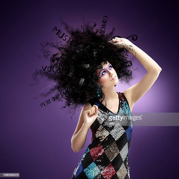 Funny disco girl dancing with a huge hairstyle