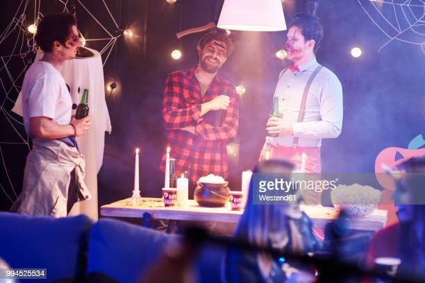 funny disussion at halloween party - halloween party stock photos and pictures