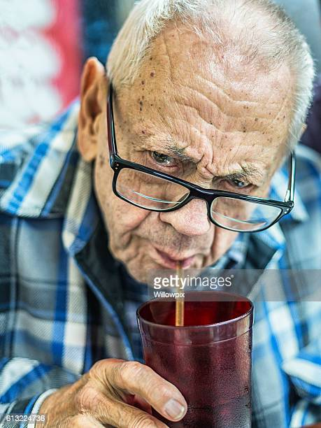 Funny Face 93 Year Old Man Sucking Soda Through Straw