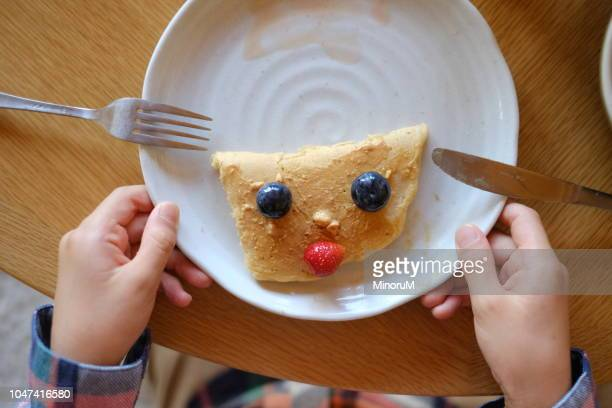 funny face pancake decorated with fruits - baby m stock pictures, royalty-free photos & images