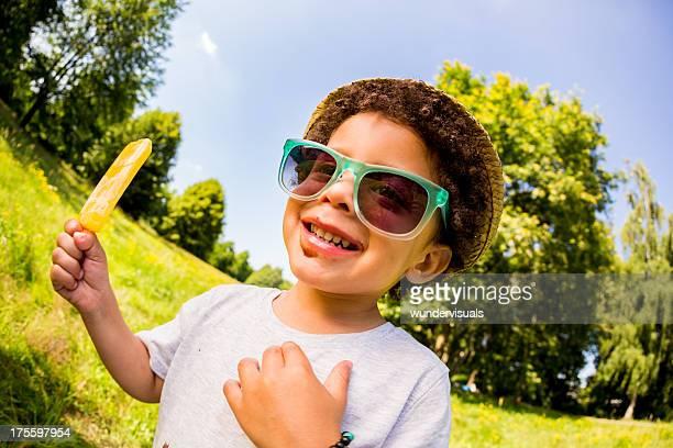 Funny Fisheye portrait of kid eating popsicle