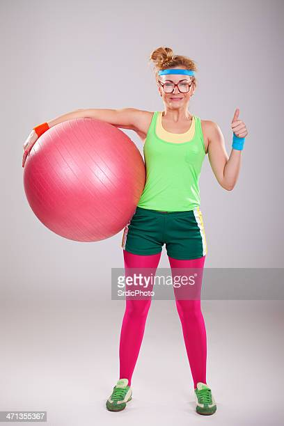 funny fitness girl holding big pink ball - ugly girl stock photos and pictures