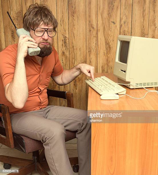 funny frustrated 1980s nerd computer man