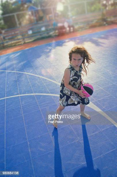 a funny girl playing basketball. - tomboy stock photos and pictures