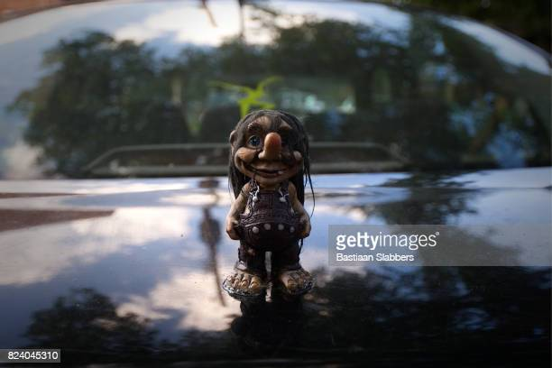 funny gnome figurine car hood ornament - hood ornament stock pictures, royalty-free photos & images