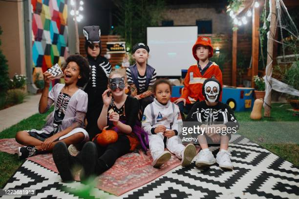 funny kids in carnival costumes outdoors. - scaredastronaut stock pictures, royalty-free photos & images